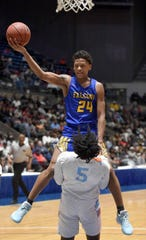 Wingfield's Jaqwone Curry (24) shoots against Callaway's Cuwandric Samuel (5) in the semifinals of the MHSAA State Basketball Tournament on Tuesday, March 3, 2020, at the Mississippi Coliseum in Jackson, Miss.