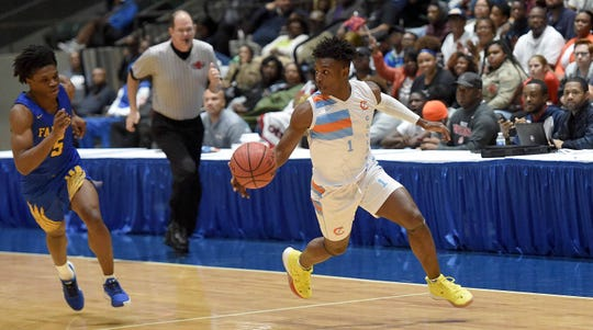 Callaway's Keiveon Hunt (1) starts the break after a steal against Wingfield in the semifinals of the MHSAA State Basketball Tournament on Tuesday, March 3, 2020, at the Mississippi Coliseum in Jackson, Miss.