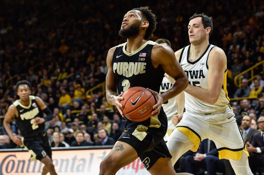 Mar 3, 2020; Iowa City, Iowa, USA; Purdue Boilermakers guard Jahaad Proctor (3) drives to the basket as Iowa Hawkeyes forward Ryan Kriener (15) defends during the first half at Carver-Hawkeye Arena. Mandatory Credit: Jeffrey Becker-USA TODAY Sports