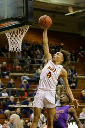 McCutcheon guard Dravyn Lawhorn (4) dunks during the fourth quarter of an IHSAA boys sectional basketball game, Tuesday, March 3, 2020 in Lafayette.