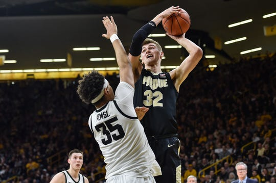 Mar 3, 2020; Iowa City, Iowa, USA; Purdue Boilermakers center Matt Haarms (32) shoots the ball over Iowa Hawkeyes forward Cordell Pemsl (35) during the first half at Carver-Hawkeye Arena. Mandatory Credit: Jeffrey Becker-USA TODAY Sports