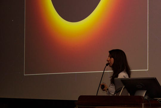 """Katie Bouman speaks during her presentation, """"Portrait of a Black Hole,"""" during the third annual Aronson Family Science and Society Honors Lecture."""