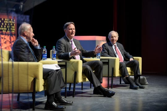 """Former Sen. Evan Bayh, center, answers a question during a discussion Tuesday, March 3, 2020, with Purdue President Mitch Daniels, left, and former Sen. Joe Lieberman about incivility in today's politics. The discussion, at Purdue's Loeb Playhouse, was part of the university's series, """"Democracy, Civility and Freedom of Expression."""""""
