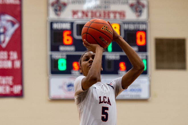 Tamera Johnson takes a shot as the LCA Knights take on Episcopal basketball., Tuesday, March 3, 2020.