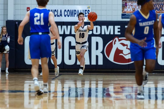 Reece Melancon passes the ball as the STM Cougars take on Vanderbilt basketball.  Tuesday, March 3, 2020.