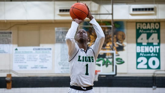 Corey Dunning takes a free throw Tuesday as Lafayette High faces Zachary in the Class 5A boys basketball quarterfinals.
