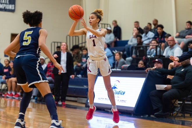 Autumn Chassion passes the ball as the LCA Knights take on Episcopal basketball., Tuesday, March 3, 2020.