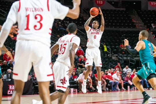 UL's Cedric Russell shoots from long distance on a night the Ragin' Cajuns made 16 3-pointers in a win over Coastal Carolina.