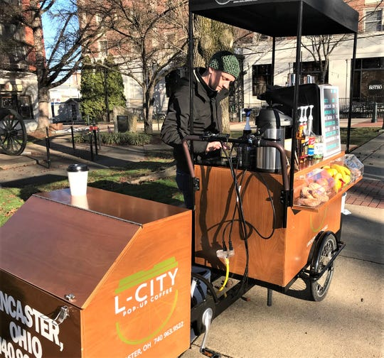 L-City Pop-Up Coffee barista Rob Gorby works at the new mobile coffee unit at Broad and Main streets Wednesday morning. Check the business Facebook page to see where in the downtown the mobile coffee stand will be each day.