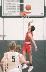 Ben Stesiak of Canton scores two of his game-high 29 points in a 52-48 loss to Howell in the KLAA basketball championship game on Tuesday, March 3, 2020.