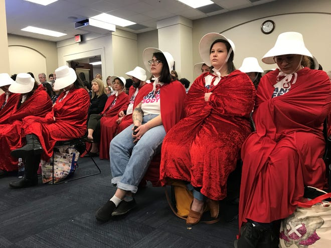 """Spectators dressed as characters from """"The Handmaid's Tale"""" attended a legislative hearing earlier this month to protest two abortion bills."""