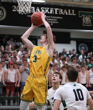 St. X's Ayden Mudd (3) shot against Trinity during their 7th Region Tournament game at Trinity High School in Louisville, Ky. on Mar. 3, 2020.