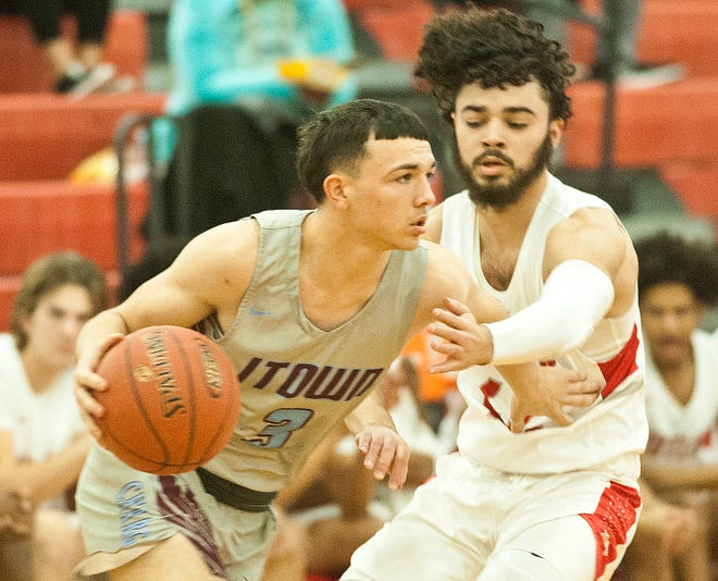 Butler guard Trey Minter pressures Jeffersontown guard Bradley Logsdon in the KHSAA 6th Region Basketball Tournament quarterfinal game.March 03,  2020