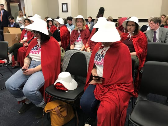 """Spectators dressed as characters from """"The Handmaid's Tale"""" showed up to protest two abortion bills before the House Judiciary Committee on Wednesday."""