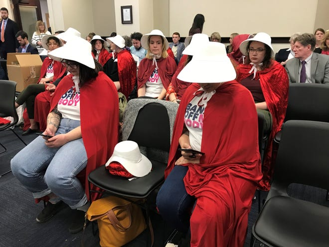 "Spectators dressed as characters from ""The Handmaid's Tale"" showed up to protest two abortion bills before the House Judiciary Committee on Wednesday."