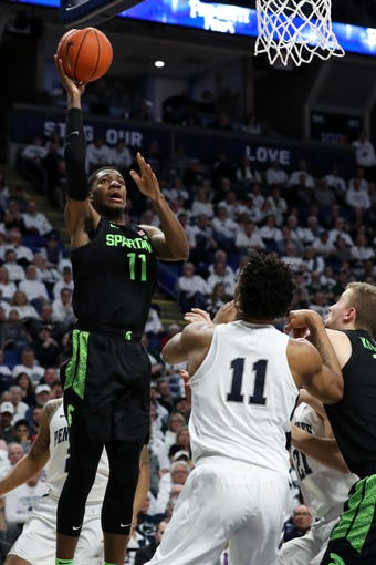 Mar 3, 2020; University Park, Pennsylvania, USA; Michigan State Spartans forward Aaron Henry (11) shoots the ball during the second half against the Penn State Nittany Lions at Bryce Jordan Center. Michigan State defeated Penn State 79-71. Mandatory Credit: Matthew OHaren-USA TODAY Sports