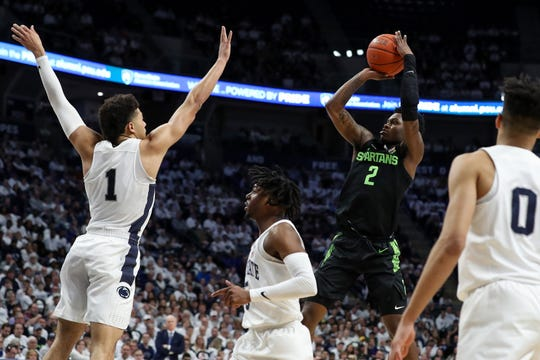 Mar 3, 2020; University Park, Pennsylvania, USA; Michigan State Spartans guard Rocket Watts (2) shoots the ball as Penn State Nittany Lions forward Seth Lundy (1) defends during the second half at Bryce Jordan Center. Michigan State defeated Penn State 79-71. Mandatory Credit: Matthew OHaren-USA TODAY Sports
