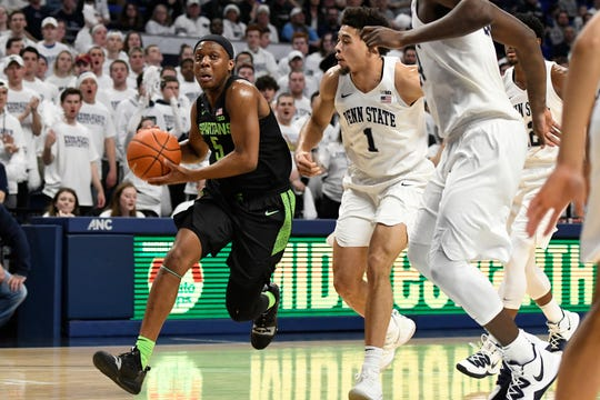 Michigan State's Cassius Winston (5) drives to the basket past Penn State's Seth Lundy (1) during the first half of an NCAA college basketball game Tuesday, March 3, 2020, in State College, Pa. (AP Photo/John Beale)