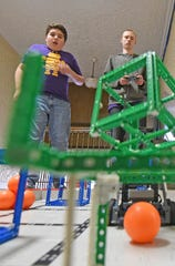 Dylan Neighbors and Damian Johnson are heading to the state robotics competition later this month.