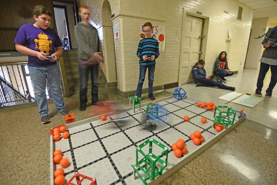 Members of Lexington's robotics team practice in the hall of Lexington Junior High School on Tuesday.
