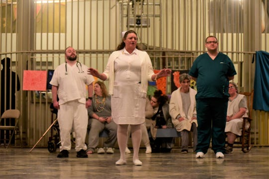 "Head Nurse Agatha, played by Mary Schalmo, addresses the audience during a ""The Madness in Murder"" rehearsal at Ohio State Reformatory."