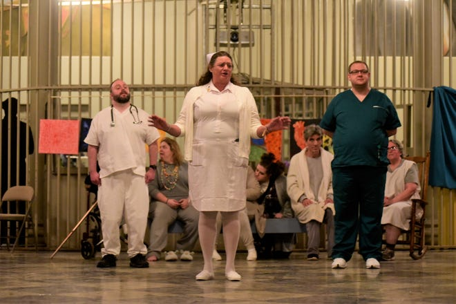 """Head Nurse Agatha, played by Mary Schalmo, addresses the audience during a """"The Madness in Murder"""" rehearsal at Ohio State Reformatory."""