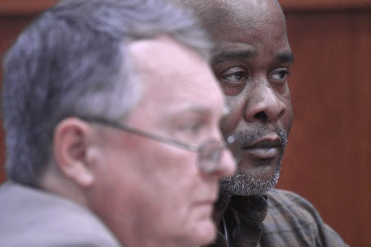 Daniel Moore, right, listens to the prosecution's opening statement with his lawyer Terry Hitchman on Wednesday during his trial. Moore, 53, of Mansfield, is charged with four counts of rape.