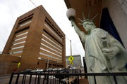A Statue of Liberty replica stands on the doorstep of Liberty Bail Bonds, Inc. just outside of The Walter L. Bailey Jr. Shelby County Criminal Justice Center at 201 Poplar Avenue.
