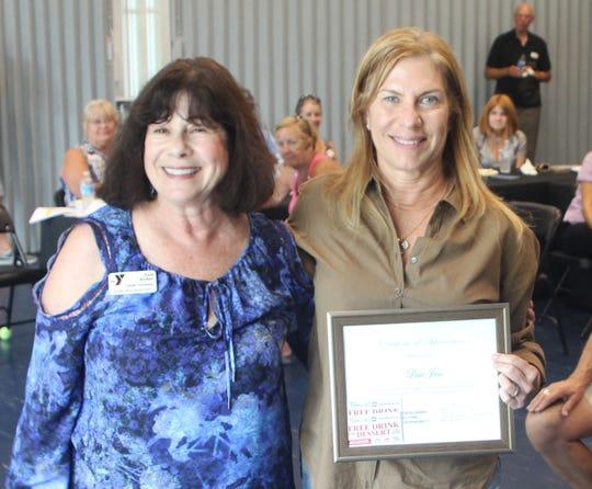 Esta Alliker, left, who runs the Y's vital program called Y-Reads, honors volunteer Lisa Jess.