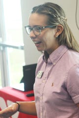 Morgan Joseph reacts as she is named the Y's employee of the year during the luncheon.