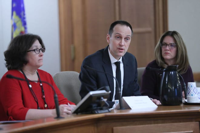 Ryan Westergaard, a chief medical officer at the Department of Health Services, answers questions for lawmakers on the coronavirus as DHS Secretary Andrea Palm, right, looks on.   Westergaard said Gov. Tony Evers could tap into state funds to help the state respond to the virus in the event of an outbreak. At left is Jeanne Ayers, State Health Officer and at right Andrea Palm, Secretary Designee.