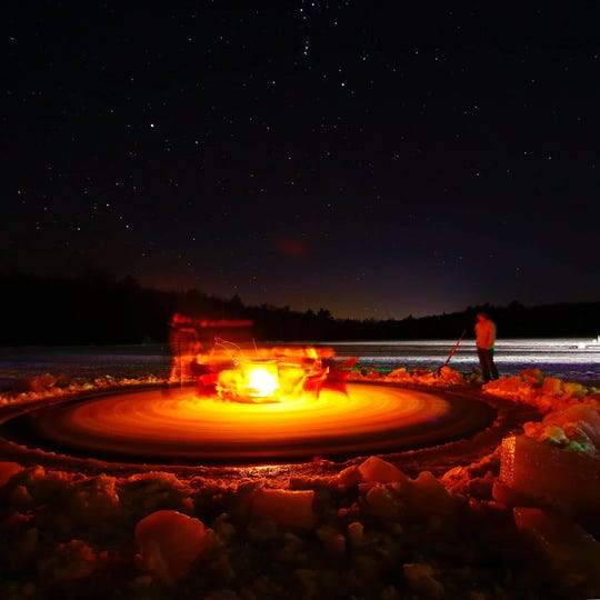 A fire burns on a spinning ice carousel at Afterglow Lake Resort in Phelps, Wisconsin, on Feb. 28, 2020.