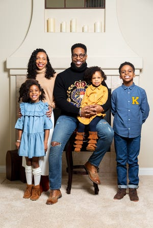 """Chloe Hines (left) and her father, DJ Hines (center) were the inspiration for the Oscar-winning animated short, """"Hair Love."""" Here they are pictured with Chloe's mom, Nina Hines, younger sister, Sedona Hines and older brother, Tres Hines."""