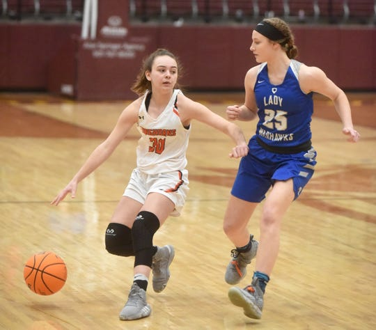 Viola freshman A.J. McCandlis is defended by Mount Vernon-Enola's Kassidy McJunkins on Tuesday night.