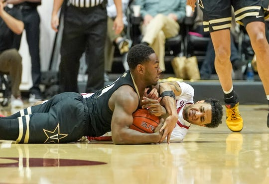 Mar 3, 2020; Tuscaloosa, Alabama, USA; Alabama Crimson Tide guard James Bolden (11) competes for a loose ball against Vanderbilt Commodores guard Isaiah Rice (14) during the first half at Coleman Coliseum. Mandatory Credit: Marvin Gentry-USA TODAY Sports