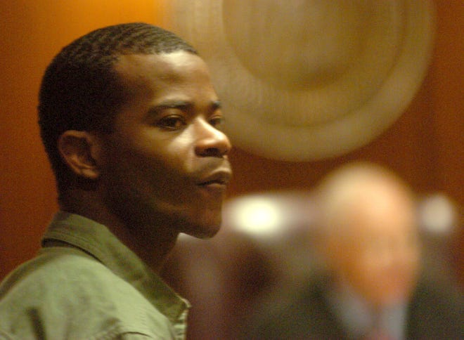FILE - In this Oct. 10, 2005, file photo, Nathaniel Woods watches as the jury enters the courtroom during his murder trial in Birmingham, Ala.