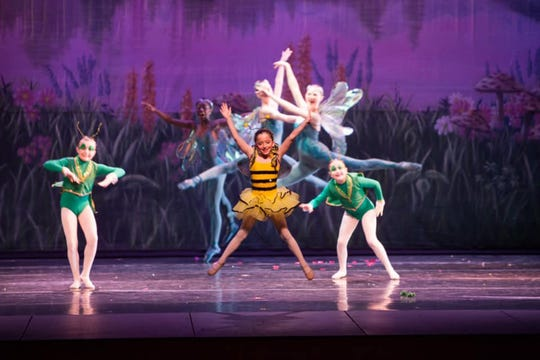 The bublebee dances on stage for Cinderella at Alabama Dance Theatre.