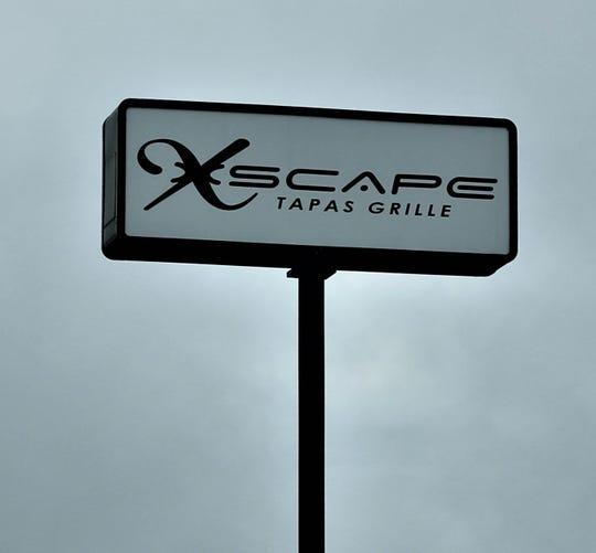 Xscape Tapas Grille sign