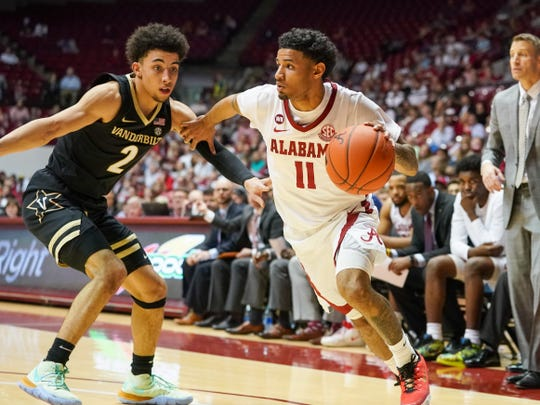 Mar 3, 2020; Tuscaloosa, Alabama, USA; Alabama Crimson Tide guard James Bolden (11) drives to the basket against Vanderbilt Commodores guard Scotty Pippen Jr. (2) during the second half at Coleman Coliseum. Mandatory Credit: Marvin Gentry-USA TODAY Sports