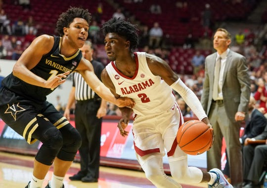Mar 3, 2020; Tuscaloosa, Alabama, USA; Alabama Crimson Tide guard Kira Lewis Jr. (2) controls the ball against Vanderbilt Commodores guard Braelee Albert (11) during the second half at Coleman Coliseum. Mandatory Credit: Marvin Gentry-USA TODAY Sports