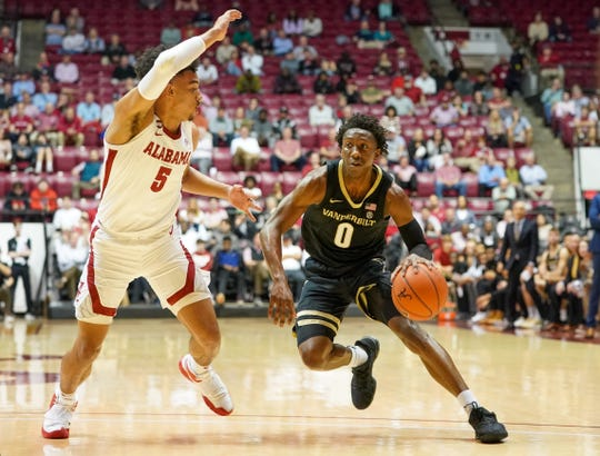 Mar 3, 2020; Tuscaloosa, Alabama, USA; Vanderbilt Commodores guard Saben Lee (0) drives to the basket against Alabama Crimson Tide guard Jaden Shackelford (5) during the first half at Coleman Coliseum. Mandatory Credit: Marvin Gentry-USA TODAY Sports