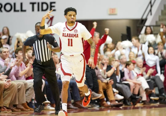 Mar 3, 2020; Tuscaloosa, Alabama, USA; Alabama Crimson Tide guard James Bolden (11) reacts after scoring a three pointer during the first half against Vanderbilt Commodores at Coleman Coliseum. Mandatory Credit: Marvin Gentry-USA TODAY Sports