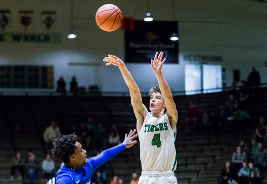 Yorktown's Luke Dunn shoots past Burris' Javon Dixon during a sectional game at New Castle High School Tuesday, March 3, 2020.