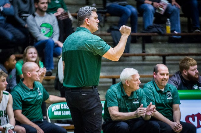 Yorktown coach Matt Moulton pumps his fist during a sectional game against Burris at New Castle High School Tuesday, March 3, 2020. Yorktown beat Burris 67-50, notching Moulton's first postseason win as a head coach.