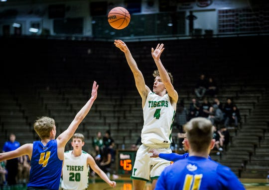 Yorktown's Luke Dunn shoots past Burris' defense during their game at New Castle High School Tuesday, March 3, 2020.