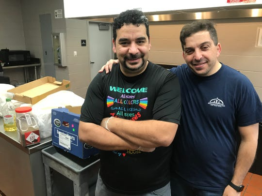 Yassin Terou, owner of Yassin's Falafel House in Knoxville, stands with Murfreesboro Muslim Youth director Abdou Kattih as the two prepare to make food with other volunteers for those affected by the deadly tornado in Nashville early Tuesday, March 3, 2020.