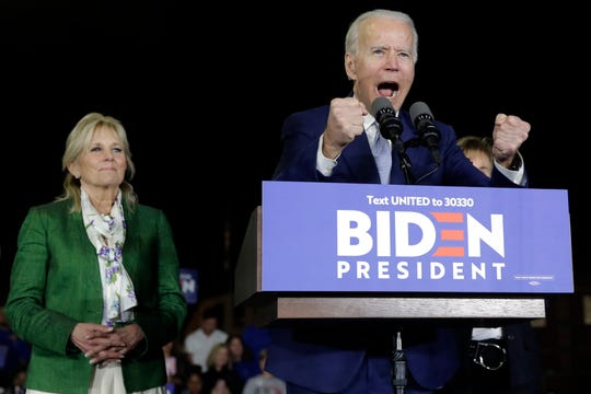 Democratic presidential candidate former Vice President Joe Biden, accompanied by his wife Jill, speaks during a primary election night rally Tuesday, March 3, 2020, in Los Angeles. (AP Photo/Marcio Jose Sanchez)