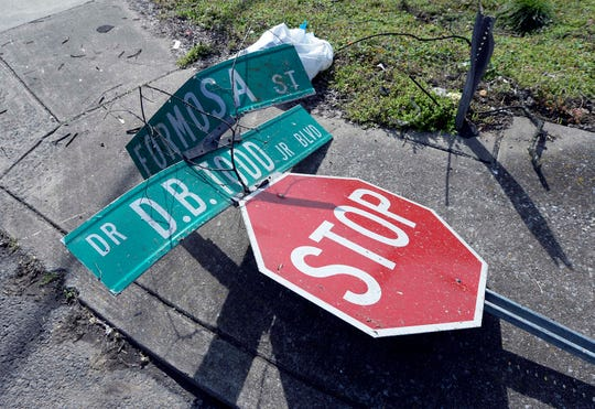 A damaged stop sign rests along 16th Avenue North on Wednesday.