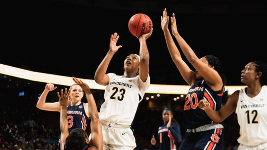 Koi Love  of Vanderbilt takes a shot as Auburn players defend during the first round of the SEC Women's Basketball Tournament in Greenville, S.C, on March 4, 2020.