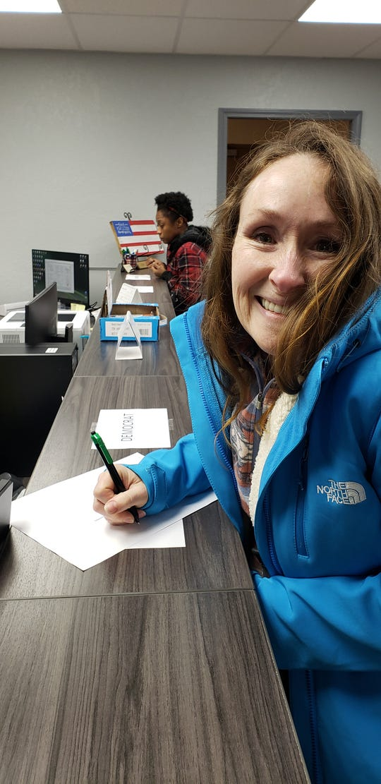 Raina Fisher votes for the first time on Feb. 12, 2020, during the presidential primary early voting in Henry County, Tennessee. Her voting rights were recently restored.